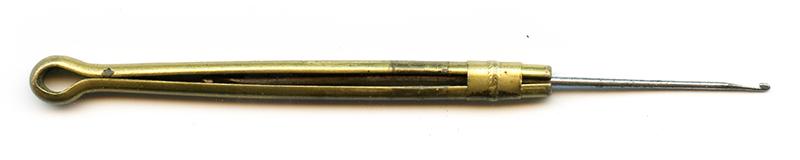 steel needle in brass pin